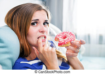Woman on diet caught during eating donut