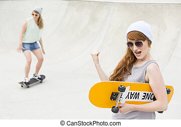 She's got this! - Shot of a girl with long hair holding a...