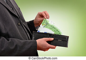 Paying in cash - Business man is paying with euro banknotes,...