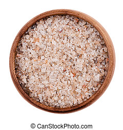 Natural red rock salt in a bowl on white background. Rough...