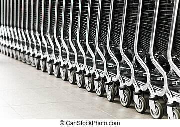 row of shopping carts - row of empty shopping carts in the...