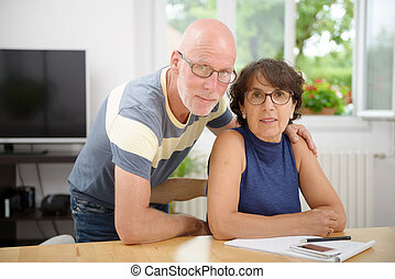 portrait of a senior couple in their home - a portrait of a...