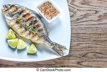 Grilled Dorade Royale Fish on the plate - Grilled Dorade...