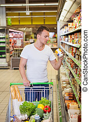 Man in supermarket - Portrait of man buy products in a...