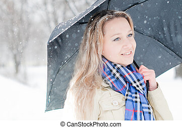 girl in winter street - young girl in the snow in winter...