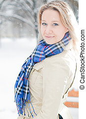 girl in winter street - young girl walking in the snow in...