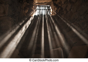 jail - sun rays beaming through the jail window into the...