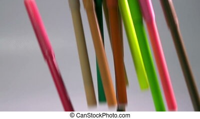 Felt-tip pens in a support, slow motion ,