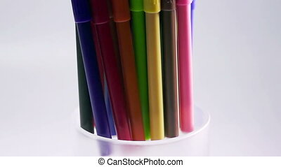 Felt-tip pens are rolled in a support, slow motion ,