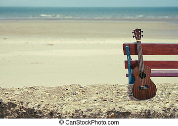 Ukulele on the beach. - Ukulele on the beautiful beach.