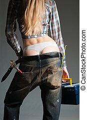 sexy mechanic - young sexy woman against dark background...