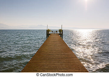 Resting place in Italy - Pier on the coastline of Garda Lake...