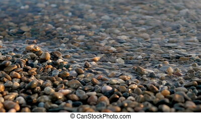 Sea Braking Against Stones And Pebbles On a Beach, Waves of...
