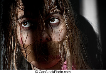 woman hostage - young woman taken hostage with her mouth...