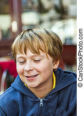 smiling young boy with closed eyes