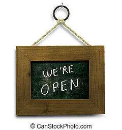 we are open sign - we are open text onto a slate with wooden...