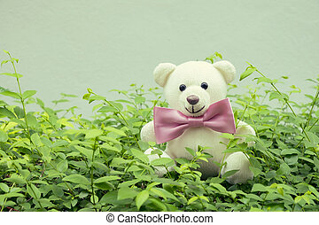 Teddy Bear with a bow tie on nature background, Vintage...
