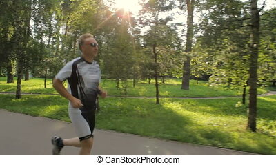 The man likes to run in the park, for a healthy lifestyle on...