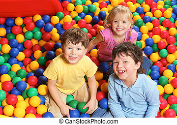 Fun - Happy lads and girl laughing while having fun in...