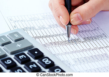Calculus - Image of female hand with pen over financial...