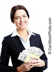 Rich woman - Portrait of happy female holding fan of dollars...