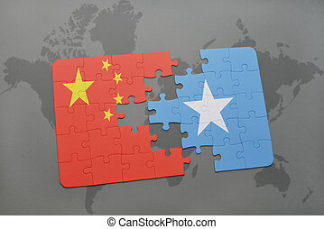 puzzle with the national flag of china and somalia on a...