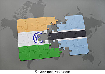puzzle with the national flag of india and botswana on a world map background.