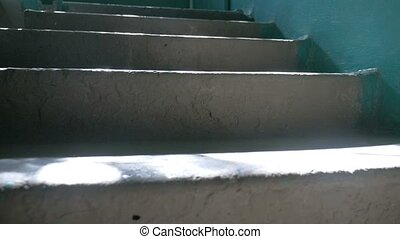 concrete steps in the entrance of sunlight falls slow motion...