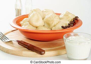 Ravioli - Image of tasty dumplings in plastic bowl served...