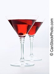 Red wine - Two martini glasses with red wine over white...