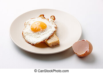 Tasty food - Close-up of fried egg on plate served with...