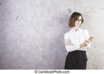 Female using smartphone - Attractive caucasian female in...
