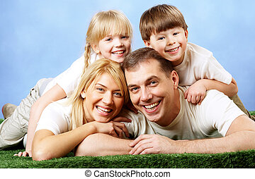 Joyful family - Photo of family members smiling at camera on...