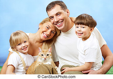 Family with pet - Portrait of affectionate family members...
