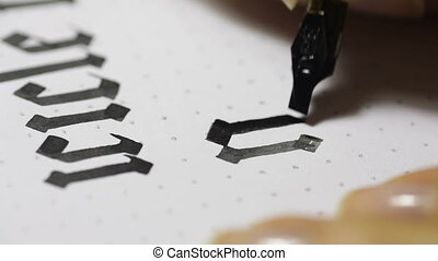female hand writes a pen calligraphic signs