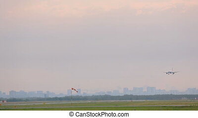 Airplane landing, city skyline - Jet airplane approaching...