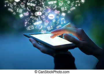 Communication concept - Closeup of hands using tablet with...