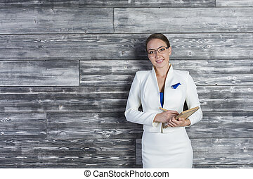 Female with notepad - Beautiful cheerful businesswoman with...