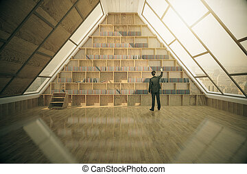 Businessman in loft library - Businessman looking for book...