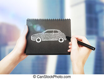 Car sketch in notepad - Male hands drawing car sketch in...
