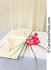 Wedding bouquet and register - A wedding register and quill...