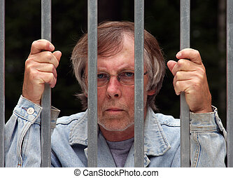man in jail - main in jail looking through bars