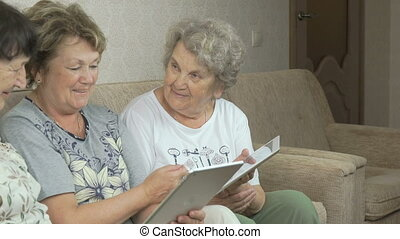 Old women talking with each other at home - Old women...