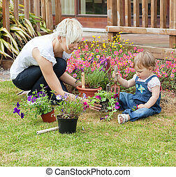 Mother showing her daughter a flower