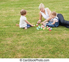 Family sitting in the grass