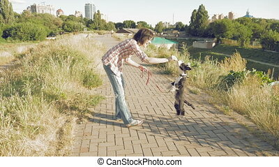 Woman with little funny dog outdoors