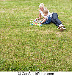 Family lying in the grass