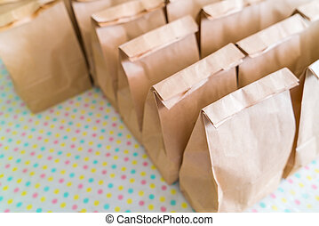 Brown paper bags on table . - Brown paper bags on table