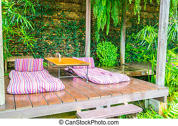Relaxation space in garden with beds .