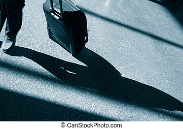 Business person walking with luggage